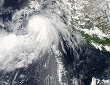 A visible satellite image of a disorganized tropical storm south of Baja California on August 23.