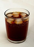 Tumbler of cola with ice.jpg