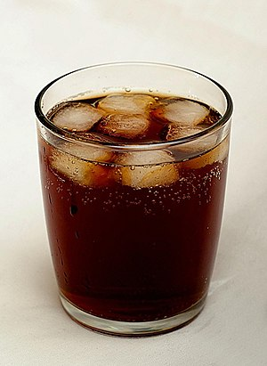 Soft drink - A glass of cola served with ice cubes