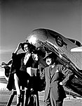 Two Models in front of a Lockheed 10B Electra, Delta Air Lines (11429452734).jpg