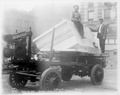 Two men with a block of marble on a cart (NYPL b11524053-ps ar cd1 09).tiff