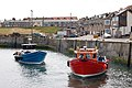 Two tourist boats manoeuvring in Seahouses harbour - geograph.org.uk - 1378018.jpg