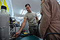U.S. Air Force Airman 1st Class Chad Tilleraas, left, an aircrew flight equipment apprentice with the 493rd Expeditionary Fighter Squadron, checks for leaks on an oxygen mask used by aircrew personnel flying 110602-F-RH591-179.jpg