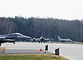 U.S. Air Force F-16 Fighting Falcon aircraft assigned to the 555th Fighter Squadron taxi at Lask Air Base, Poland, before taking off for a training mission March 18, 2014 140318-F-BH566-354.jpg