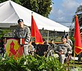 U.S. Army Lt. Gen. Jeffrey Talley, at the podium, the chief of Army Reserve, and the commanding general of the U.S. Army Reserve Command gives remarks at the change of command ceremony of the 1st Mission Support 131214-A-CV700-007.jpg