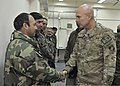 U.S. Army Lt. Gen. Joseph Anderson, right, the commander of the International Security Assistance Force Joint Command, shakes hands with an Afghan officer during a tour of the Afghan National Army Consolidated 140220-N-VZ328-143.jpg