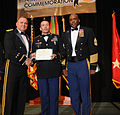 U.S. Army Pacific Commanding General, Lt. Gen. Francis J. Wiercinski, and 8th Theater Sustainment Command senior enlisted advisor, Command Sgt. Maj. Nathan Hunt, present an award to Staff Sgt. Neal Lang III 120615-A-YK011-016.jpg