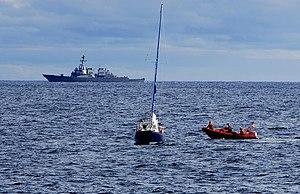 U.S. Coast Guard and Navy crews combine effort...