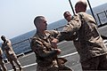 U.S. Marine Corps 1st Lt. Jordan Miller, left, and Lance Cpl. Branden Cooper, with Security Cooperation Task Force Africa Partnership Station (APS) 2012, practice Marine Corps Martial Arts Program techniques on 120804-M-JU449-144.jpg