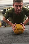 U.S. Marine Corps Lance Cpl. Michael Vinard, with the command element of the 24th Marine Expeditionary Unit, participates in the combat conditioning portion of the Warrior of the Month event in the hangar bay 120501-M-RO494-039.jpg