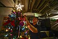 U.S. Navy Culinary Specialist 3rd Class Haidavid Tran decorates a Christmas tree on the mess decks aboard the guided missile cruiser USS Monterey (CG 61) Dec. 15, 2013, in the Mediterranean Sea 131215-N-QL471-036.jpg