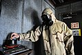 U.S. Navy Equipment Operator 2nd Class Sam Sutheimer, a Sailor with Naval Mobile Construction Battalion 5, activates CS gas during a gas mask training exercise in the confidence chamber at the Naval Construction 110224-N-SI773-328.jpg