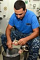 U.S. Navy Hospital Corpsman 2nd Class Joseph Vargas fabricates a mouth guard aboard the aircraft carrier USS Ronald Reagan (CVN 76) Nov. 9, 2013, in the Pacific Ocean 131109-N-AV746-264.jpg