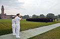 U.S. Navy Rear Adm. Gary Jones, commander, Naval Education and Training Command, and Capt. Caroline M. Olinger, commanding officer, Training Support Center, salute A School students and staff from Training 090611-N-IK959-020.jpg