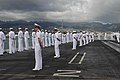 U.S. Sailors man the rails on the flight deck of the aircraft carrier USS Ronald Reagan (CVN 76) as the ship pulls into Joint Base Pearl Harbor-Hickam, Hawaii, June 26, 2014, to participate in exercise Rim 140626-N-OC010-121.jpg