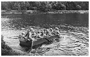 289th Engineer Combat Battalion (United States) - Combat engineers ferrying infantry in M2 assault boat