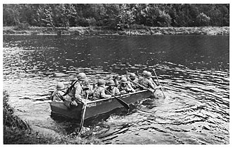 Engineer Combat Battalion - Combat Engineers ferried infantry and special forces troops in craft such as this M2 assault boat in Europe in World War II