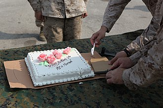 Ka-Bar - Two USMC officers using, in accord with service tradition, a Ka-Bar knife to lift a serving of cake they have just cut, in a Marine Corps birthday ceremony on a flight line in Pakistan.