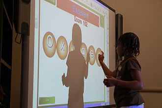Educational video game - A student uses a Smart Board in class.