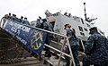 USS Freedom conducts a crew swap. (9423038702).jpg