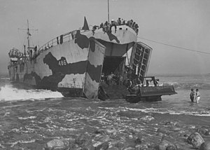 USS LST-486 beached at San Clemente, CA., while unloading a bulldozer during Acorn Training, 9 January 1944.