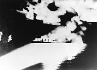 USS Quincy (CA-39) under fire during the Battle of Savo Island on 9 August 1942 (NH 50346).jpg