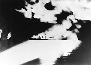 USS Quincy (CA-39) - Quincy caught in Japanese searchlights, moments before sinking off Savo Island with great loss of life, on 9 August 1942