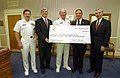 US Navy 020911-N-2383B-654 CNO and MCPON accept a donation from the Navy League.jpg