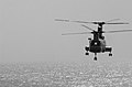 """US Navy 021023-N-5471P-004 A CH-46 """"Sea Knight"""" helicopter carries supplies to the Mobile Bay during a replenishment at sea (RAS) with the USS Camden (AOE 2).jpg"""