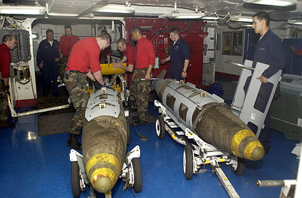 Attaching a GPS guidance kit to a dumb bomb, March 2003. US Navy 030319-N-4142G-020 Ordnance handlers assemble Joint Direct Attack Munition (JDAM) bombs in the forward mess decks.jpg
