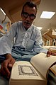 US Navy 030424-N-6967M-324 A patient reads the Koran while recovering aboard USNS Comfort (T-AH 20).jpg