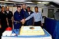 US Navy 030429-N-9788M-001 Capt. Tom Parker, Commanding Officer, USS Kitty Hawk (CV 63), cuts a cake commemorating Kitty Hawk's 42nd Birthday.jpg