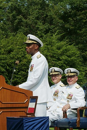 Barry Black -  Rear Adm. Barry C. Black, chief of navy chaplains remarks after receiving the Navy Distinguished Service Medal from Adm. Vern Clark, chief of naval operations (CNO). Sitting (center) and next to the CNO, Rear Adm. Christopher E. Weaver, commandant, Naval District Washington, during the change of office and retirement ceremony at the Washington Navy Yard, August 15, 2003