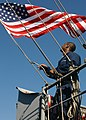 US Navy 040326-N-1045B-048 Signalman 3rd Class Christopher Clark, of Washington, D.C., raises the American Flag on the signal bridge aboard USS George Washington (CVN 73).jpg