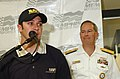 US Navy 041022-N-5862D-013 Commander, Navy Recruiting Command, Rear Adm. Jeff Fowler, right, looks-on as the new driver of the Busch Series Life Accelerator, David Stremme, takes questions.jpg