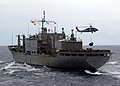 US Navy 041219-N-1229B-032 An MH-60S Knighthawk Helicopter assigned to Helicopter Combat Support Squadron Five (HC-5), transports supplies from the Military Sealift Command (MSC) combat stores ship USNS San Jose (T-AFS 7) to US.jpg