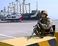 US Navy 050228-N-9563N-002 U.S. Marine Corps Lance Cpl. Clay Skeens, assigned to Interim Marine Corps Security Force (IMCSF), stands guard during exercise Desert Sailor 2005.jpg