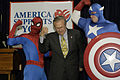 US Navy 050428-N-0295M-004 Secretary of Defense Donald Rumsfeld flexes his muscles with superheroes Spider-Man and Captain America Spider-Man during the unveiling of a comic book that will be distributed free to U.S. forces in.jpg