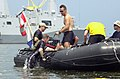 US Navy 050817-N-1928O-073 Chief Hull Technician Jeff H. Bailey is helped aboard by fellow diver Senior Chief Boatswain's Mate James E. Pruitt following tests on an submerged acoustic swimmer detection system.jpg