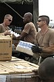US Navy 050901-N-0318R-035 National Guardsmen from the Biloxi, Miss. area, load the back of a High Mobility Multipurpose Wheeled Vehicle (HMMWV) at the Gulf Port International Airport, full of bottles of water.jpg