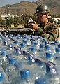 US Navy 051027-N-1261P-010 U.S. Navy Builder Constructionman James Sachsel, assigned to Naval Mobile Construction Battalion Seven Four (NMCB-74), stays hydrated while improving camp life in Muzafarrabad, Pakistan.jpg