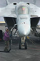 US Navy 051031-N-6106R-091 An Sailor assigned to the Air Department's fuel division, fuels an F-A-18E Super Hornet.jpg