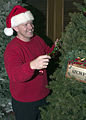 US Navy 051130-N-5686B-001 U.S. Navy Cryptologic Technician 1st Class Robert Hawkins, assigned to Afloat Training Group Western Pacific, decorates the command's Christmas tree.jpg