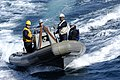 US Navy 060522-N-3136P-034 Deck department Sailors assigned to the USS Kitty Hawk (CV 63) return to the ship in a Rigid-Hull Inflatable Boat (RHIB) after completing a small boat exercise.jpg