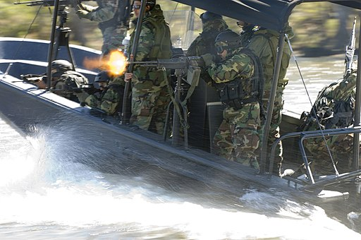 US Navy 061023-N-5319A-108 An Iraqi Soldier assigned to Iraqi Riverine Police Force fires a M-60 machine gun during special boat maneuvers and weapon handling training at Stennis Space Center