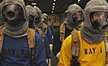 US Navy 070117-N-8923M-038 Fire team members stand by while waiting to respond to several simulated fires in the hangar bay during a general quarters drill on board the Nimitz-class aircraft carrier USS Harry S. Truman (CVN 75).jpg