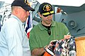 US Navy 070514-N-7975R-004 During a visit to USS Winston S. Churchill (DDG 81), Philadelphia Flyers Right Winger Mike Knuble took time to give an autograph to Fire Controlman 2nd Class Gerard Jossaume.jpg