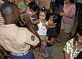 US Navy 070630-N-6410J-098 Marine Forces Pacific Band Sgt. Ryan Morris receives a high five and a smile from a small girl after an evening concert.jpg