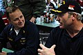 US Navy 071213-N-3659B-164 Senior Chief Cryptologic Technician (Technical) Gerald Del Sasso talks with retired National Hockey League star Marty McSorley on the aft mess decks of the Nimitz-class nuclear-powered aircraft carrie.jpg