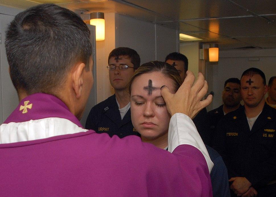 US Navy 080206-N-7869M-057 Electronics Technician 3rd Class Leila Tardieu receives the sacramental ashes during an Ash Wednesday celebration